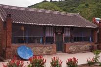 Farmhaus, hier gibt es Kaffe und chinesische Suppen